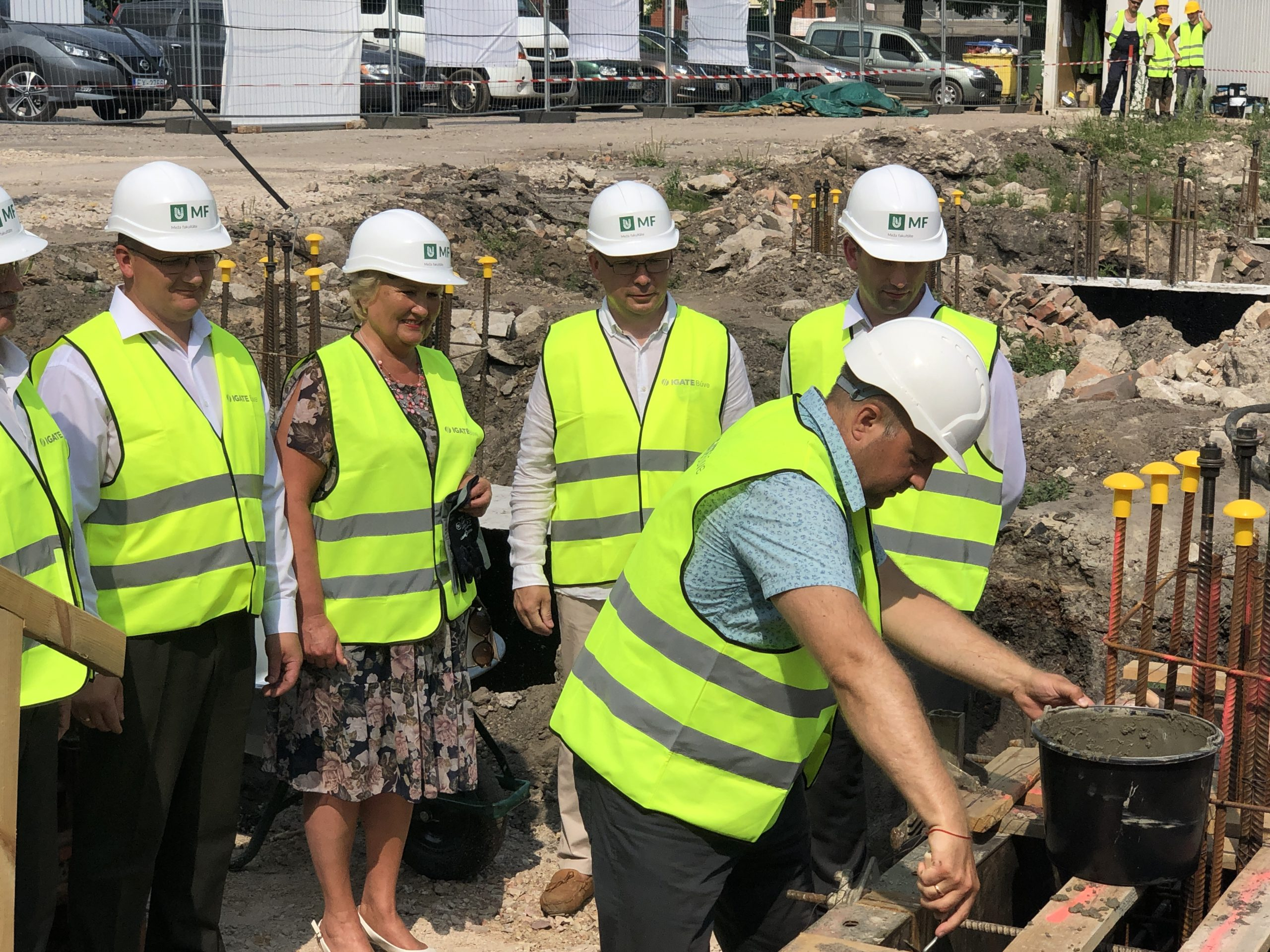 Māris Peilāns Head of ZAZA TIMBER Construction laying time capsule in foundations of a university research lab
